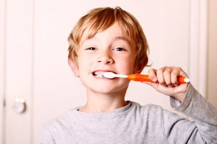 Little boy brushing teeth after first dental visit at Grove Street Family Dentistry in Marysville, WA